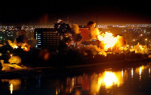 Bombs fall on government buildings along the Tigris River in the heart of Baghdad, later referred to as the Green Zone.